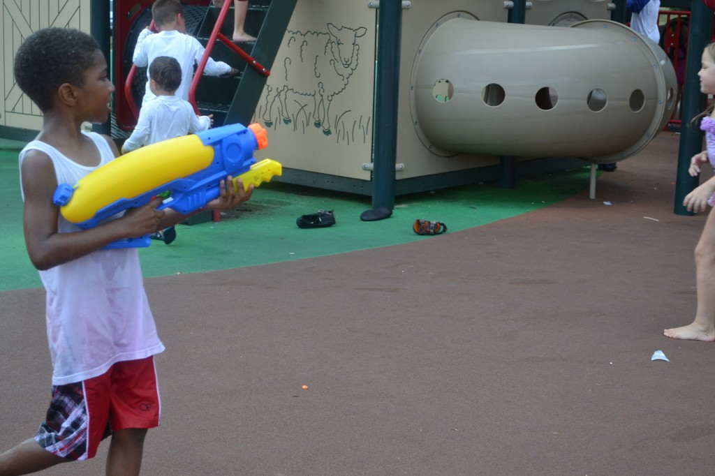 little boy and his water gun