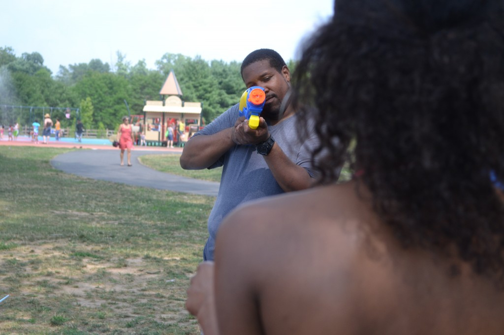 Brother-In-Law sets Sister-In-Law in his water gun sights