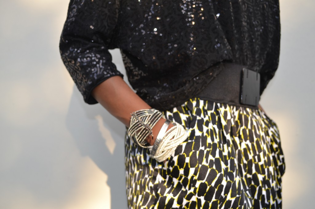 "black sequin shirt, black, white and yellow skirt and ""arm candy"""