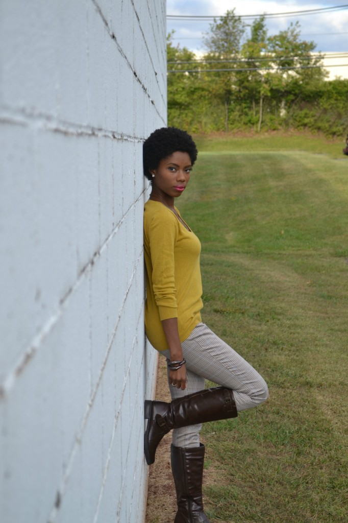 Mustard colored sweater, patterned pants, dark brown knee high boots