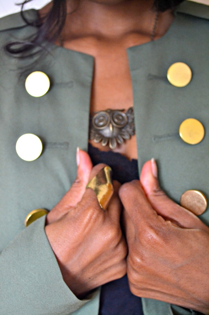 military style jacket with gold detail, gold knuckle ring, owl necklace