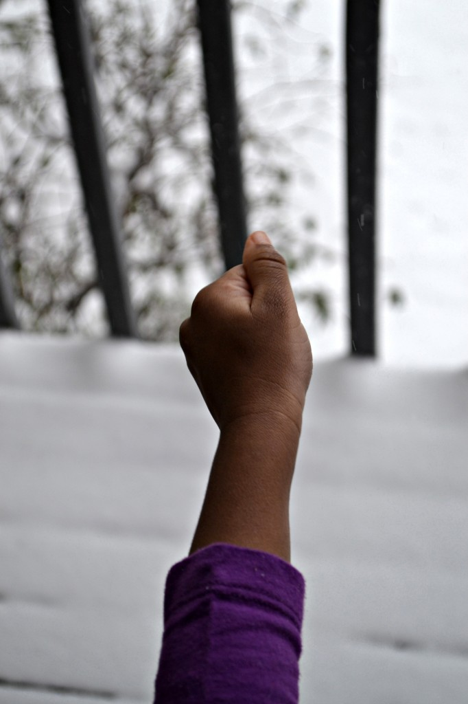 little kid hand catching snow