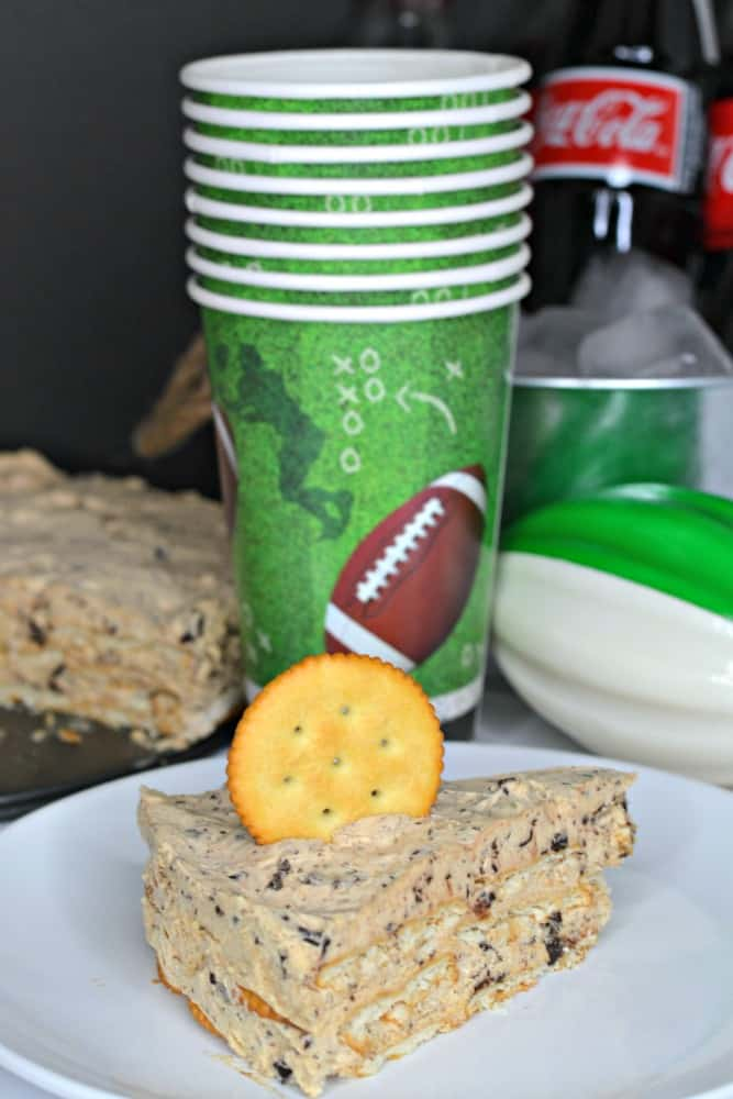 I never thought to use RITZ® Crackers in an icebox cake! This Peanut Butter Chocolate Icebox Cake looks so good. It's perfect for the big game. #BowlTimeSnacks #ad