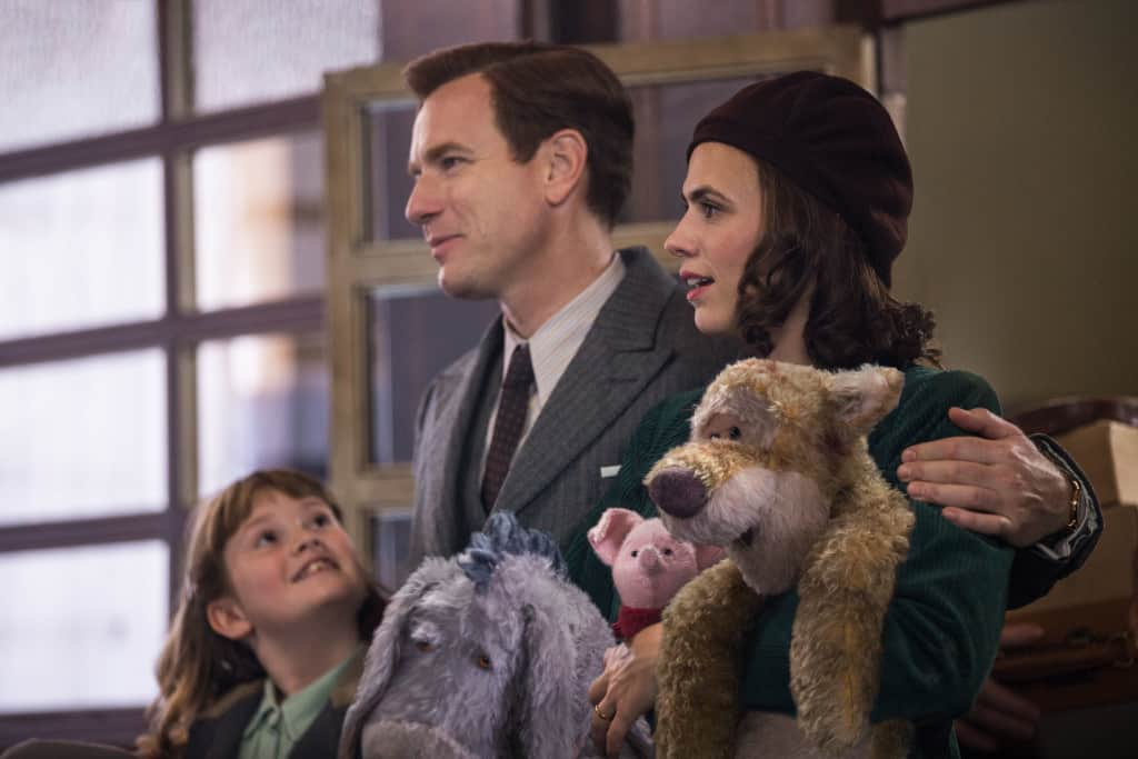 Madeline Robin (Bronte Carmichael), Christopher Robin (Ewan McGregor), Evelyn Robin (Hayley Atwell), Eeyore, Piglet and Tigger in Disney's live-action adventure CHRISTOPHER ROBIN.