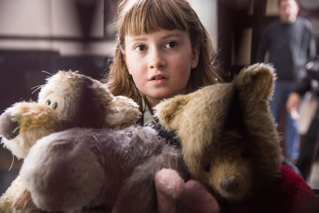 Madeline Robin (Bronte Carmichael) with her new friends Tigger, Eeyore and Pooh in Disney's live-action adventure CHRISTOPHER ROBIN.