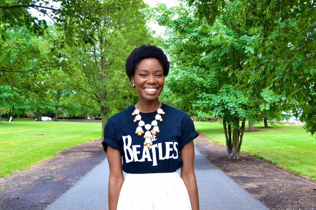Beatles tee, bauble necklace and an afro