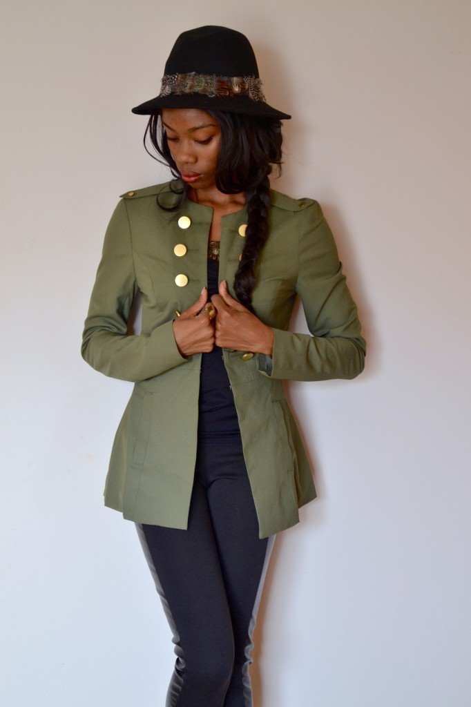military style jacket over a monochromatic outfit, with gold details