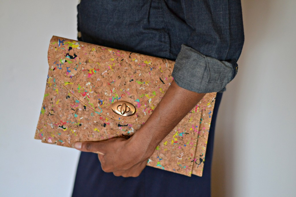 Oversized clutch with paint-splattered detail from JustFab