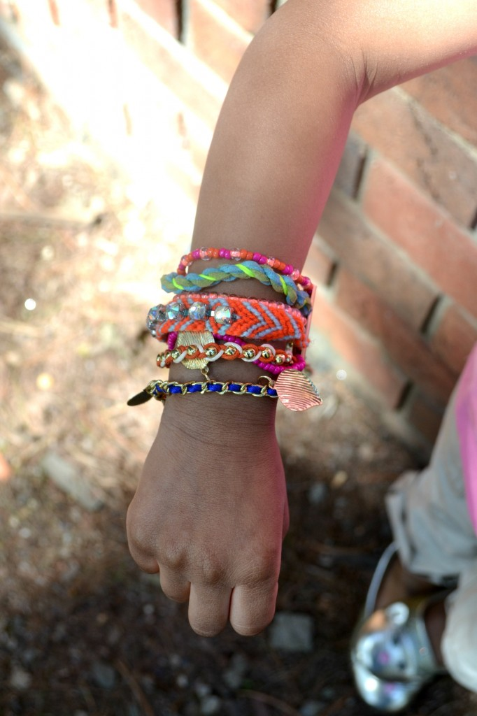 Colorful stacked bracelet on a little preschool fashionista