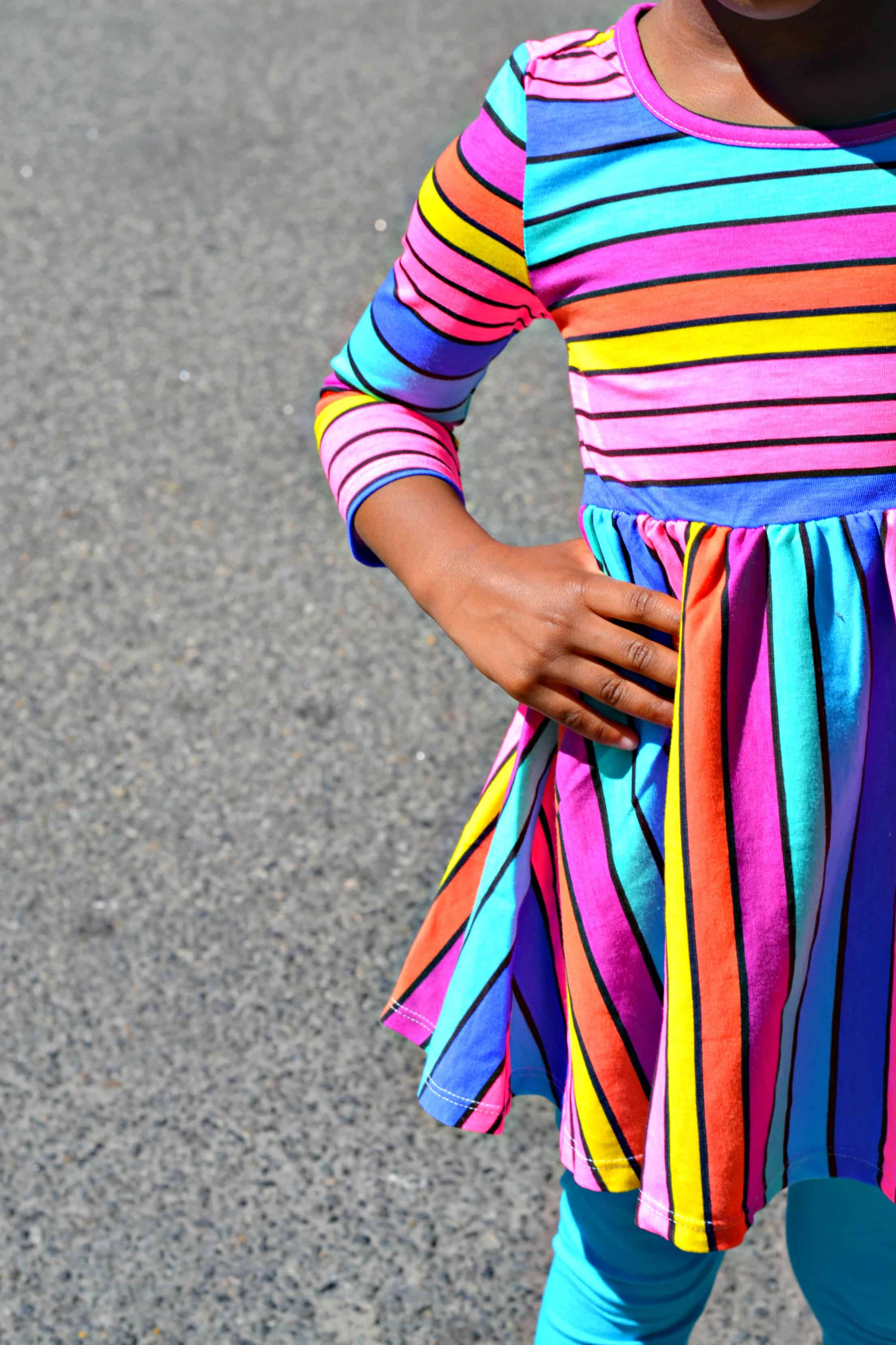 You can't go wrong with a colorful striped dress, especially on a little girl. Check out the dress this little fashionista is loving right now.