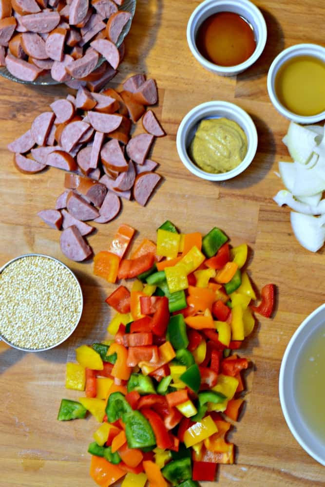 This slow cooker quinoa with sausage and peppers is so easy to make, delicious, and healthy!