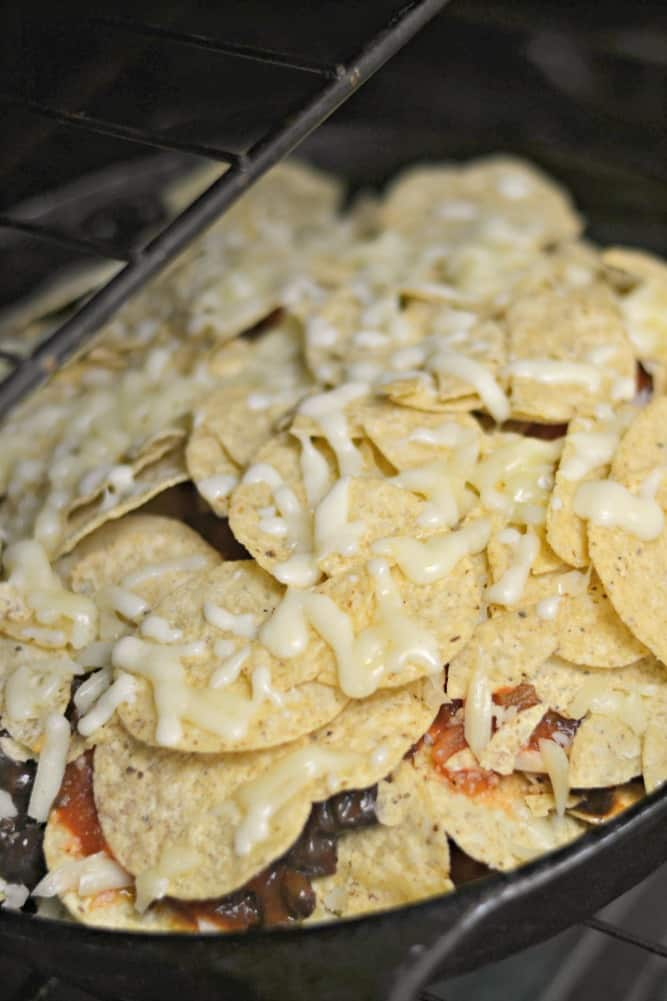 Making nachos is easy enough, but this simple Nacho Pie takes things to another level. Made in a cast iron skillet, it's bubbly and delicious!