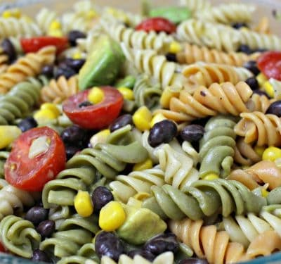 Need a quick, meatless weeknight meal? This Southwest Pasta Salad is it! Full of beans, avocado, and veggies; serve it as a side dish or main course.