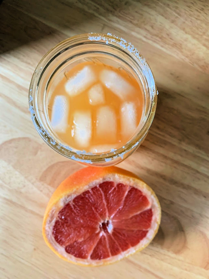 Want a change to your usual margarita recipe? This ginger grapefruit margarita is a fun cocktail to try if you love tequila and citrus!
